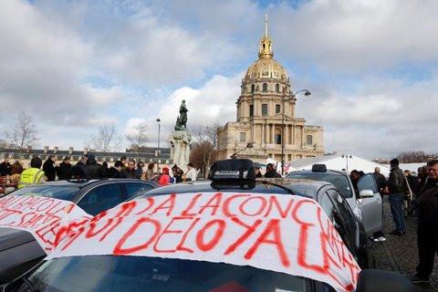 01E0000007130763-photo-manifestation-de-chauffeurs-de-taxis-contre-la-concurrence-jug-e-d-loyale-des-vtc-paris-le-13-janvier-2014.jpg