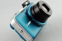 00c8000004360760-photo-canon-powershot-sx230-hs-poign-e.jpg