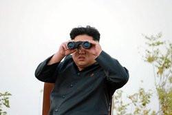 00FA000007694155-photo-photo-non-dat-e-du-dirigeant-nord-cor-en-kim-jong-un-diffus-e-le-19-octobre-2014.jpg