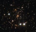 Hubble dévoile un cliché de Sunburst Arc, une galaxie à 11 milliards d'années-lumières de la Terre