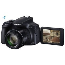 Powershot SX60 HSISO 100 ISO 400 ISO 1600 Bridge ISO 800 ISO 200 Secure Digital ISO 160 CMOS ISO 3200 WiFi ISO 1000 Électronique Optique SDHC (Secure Digital High Capacity) ISO 2000 ISO 1250 SDXC ISO 125 ISO 250 ISO 2500 ISO 320 ISO 500 ISO 640 7,5 cm Full HD (1920 x 1080) Auto 3 Pouces Integré NFC 16,1 Mégapixel(s) 65x 650 g